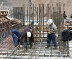 construction workers setting rebar on a hospital construction site